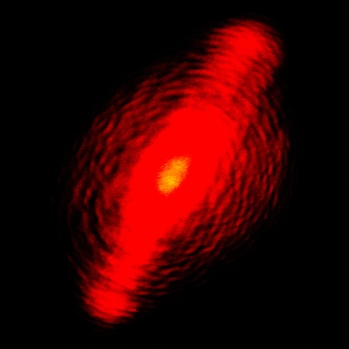"""This is a wave interference pattern on a """"laser dot"""" generated because the collimating lens wasn't quite aligned yet."""
