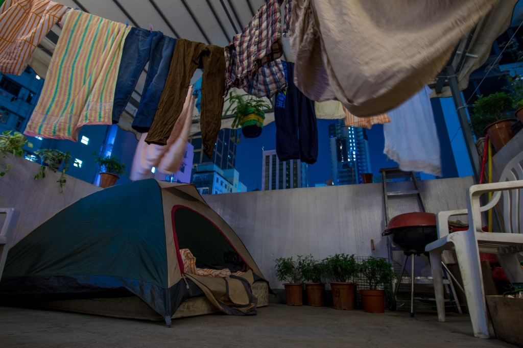 Sleep on top of a crumbling high-rise in Hong Kong? Shady? Yes. Interested? Absolutely!