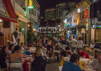 Throngs gather on Club Street for late-night adventures.