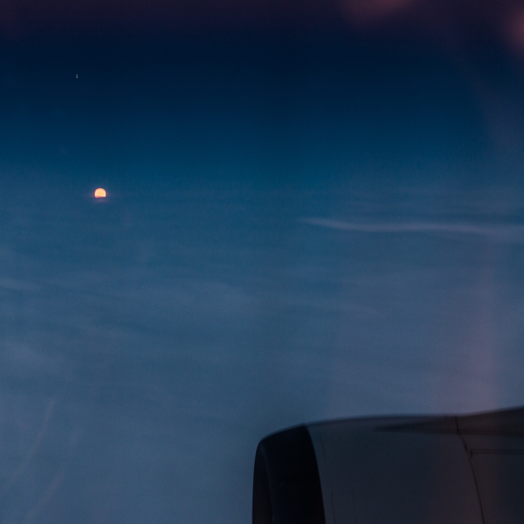The sun set and rose during my journey westward. Here it was just popping up above the horizon to welcome us to Europe.