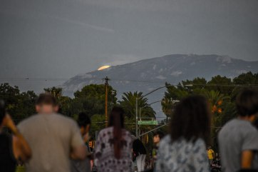 The moon peeking over the horizon - a moment of excitement for everyone who came, after lots of waiting.