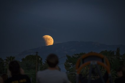 Probably the most awe-inspiring time of the night was seeing the partially-eclipsed moon rise over the mountain.