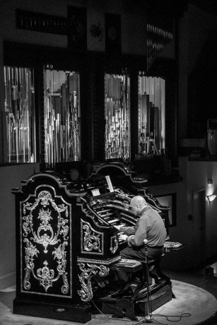 The organist plays with both hands and both feet, a feat of coordination and independence that must take extreme focus.